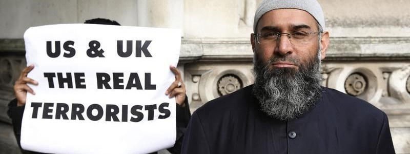 Demonstrator Anjem Choudary, protests in support of Islamist cleric Abu Hamza al-Masri, outside the High Court in London